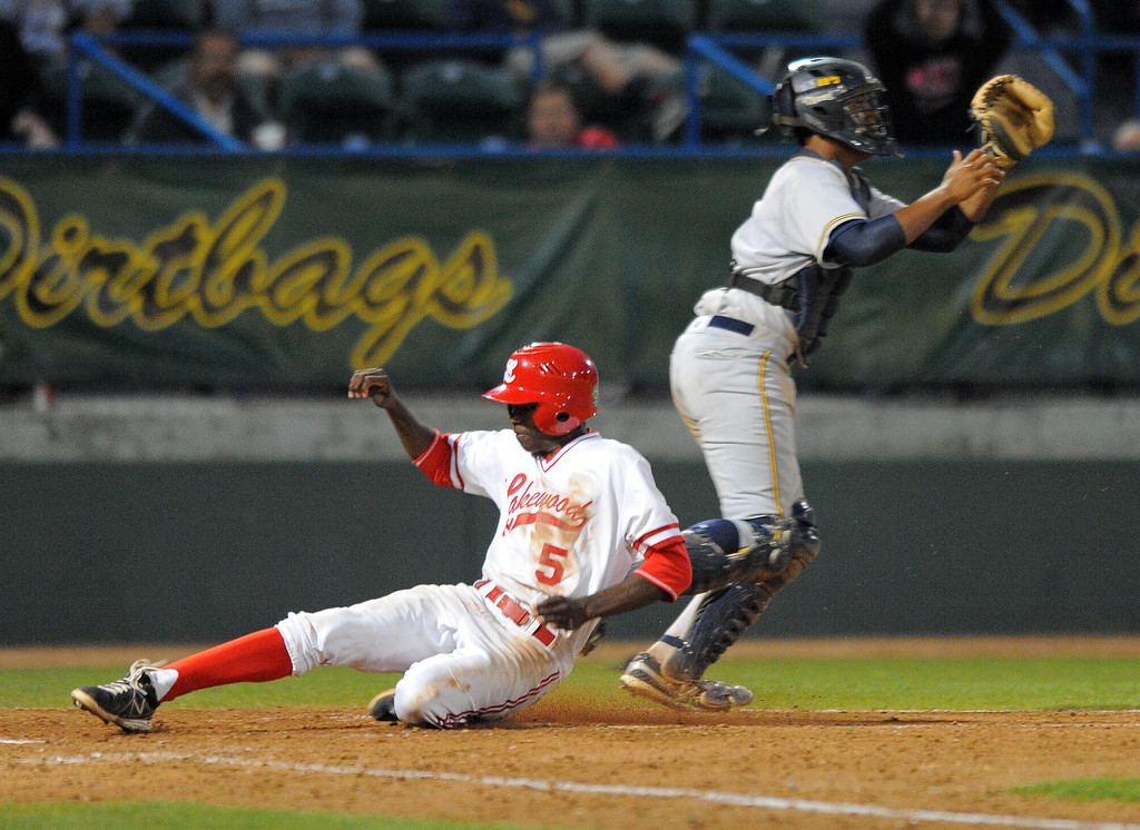 . LONG BEACH - 05/01/13 - (Photo: Scott Varley, Los Angeles Newspaper Group)  Lakewood vs Millikan baseball at Blair Field. Lakewood\'s Manny Jefferson ties the game up in the 5th as Millikan\'s catcher Giovanny Higueros waits for the throw.