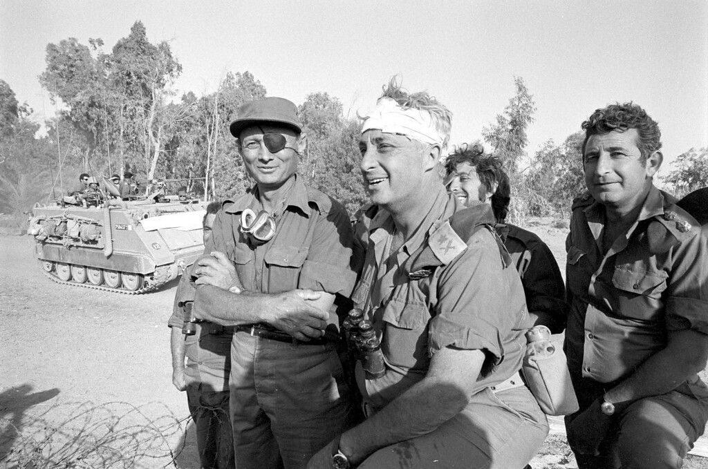 . A file picture taken in October 1973 and provided by the Israeli Army shows Ariel Sharon (C) with Moshe Dayan (L) on the western side of the Suez Canal during the Yom Kippor war.  AFP PHOTO/IDF HO-/AFP/Getty Images