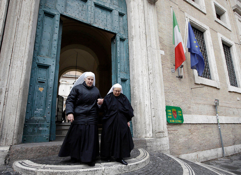 . Nuns leave a polling station after voting in downtown Rome, Sunday, Feb. 24, 2013. Italy votes in a watershed parliamentary election Sunday and Monday that could shape the future of one of Europe\'s biggest economies. (AP Photo/Andrew Medichini)