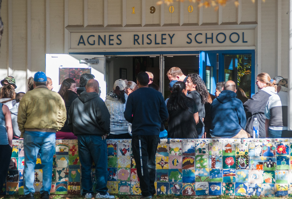 . Parents wait for officials to release their children from Agnes Risley Elementary School, where some students were evacuated to after a shooting at Sparks Middle School on Monday, Oct. 21, 2013 in Sparks, Nev. (AP Photo/Kevin Clifford)