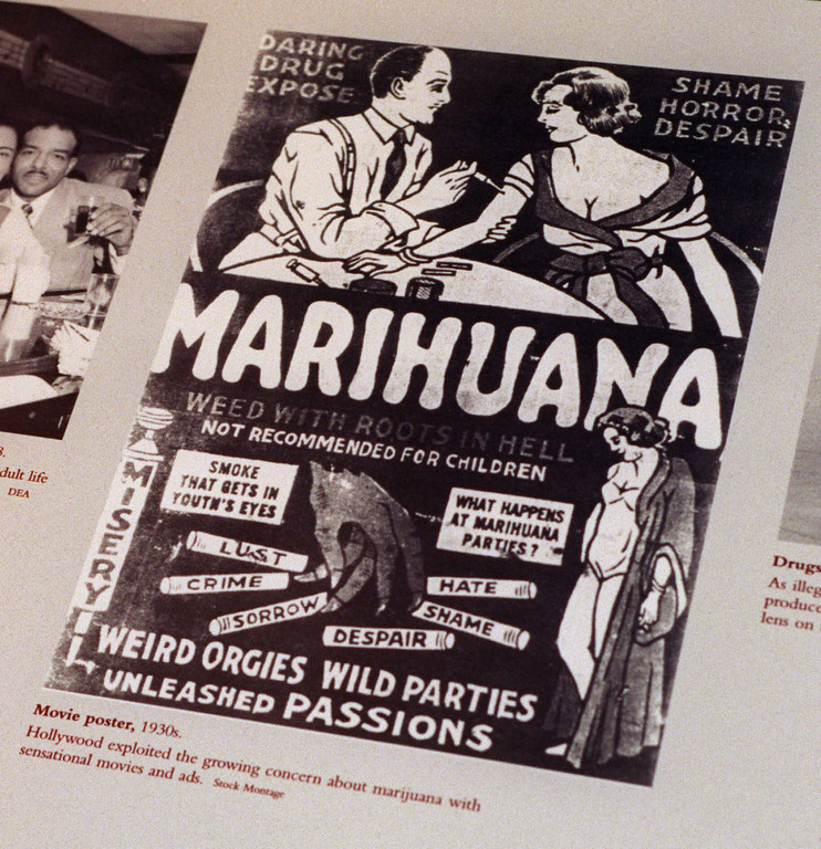 ". FILE - This undated file photo provided by the Drug Enforcement Administration shows a 1930s anti-marijuana movie poster as part of an exhibit at the DEA Museum and Visitors Center which opened May 10, 1999 in Arlington, Va. After the repeal of alcohol prohibition in 1933, Harry Anslinger, who headed the Federal Bureau of Narcotics, turned his attention to pot. He told of sensational crimes reportedly committed by marijuana addicts. ""No one knows, when he places a marijuana cigarette to his lips, whether he will become a philosopher, a joyous reveler in a musical heaven, a mad insensate, a calm philosopher, or a murderer,\"" he wrote in \""Marijuana: Assassin of Youth,\"" in 1937. On the occasion of  �Legalization Day,� Thursday, Dec. 6, 2012, when Washington�s new law takes effect, AP takes a look back at the cultural and legal status of the �evil weed� in American history. (AP Photo/DEA, File)"