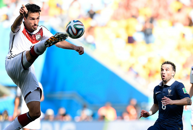 . Germany\'s defender Mats Hummels (L) jumps for the ball as France\'s midfielder Mathieu Valbuena watches on during the quarter-final football match between France and Germany at the Maracana Stadium in Rio de Janeiro during the 2014 FIFA World Cup on July 4, 2014. (FRANCK FIFE/AFP/Getty Images)
