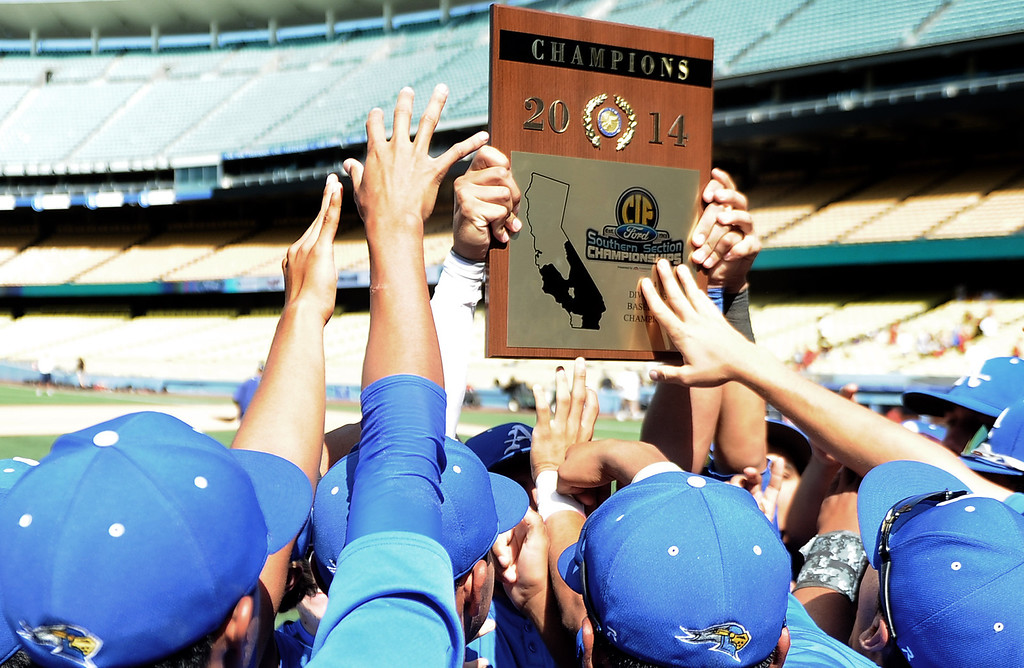 . Bishop Amat holds up the championship trophy after defeating Palm Desert 4-3 to win the CIF-SS Division 3 baseball championship at Dodger Stadium in Los Angeles on Friday, June 6, 2014. 