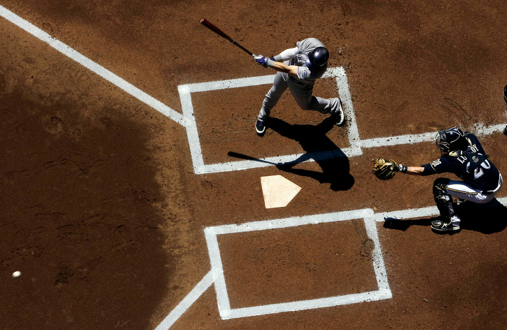 . Colorado Rockies\' Corey Dickerson hits a two-run double during the first inning of a baseball game against the Milwaukee Brewers Sunday, June 29, 2014, in Milwaukee. (AP Photo/Morry Gash)
