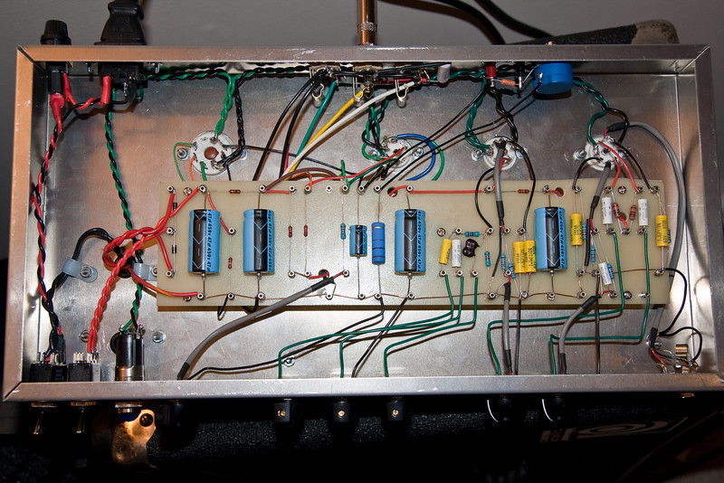 An overall shot of the wiring as it stands now, with octal tube socket and variable bias, along with several other mods done to increase bass response