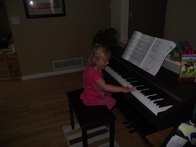April 2012 - piano lessons and lost tooth