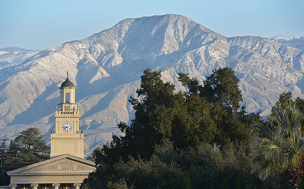 . A dusting of snow blankets the mountain side behind Memorial Chapel at the University of Redlands in Redlands, Calif.,  December 31, 2014. Snow left behind by Tuesday\'s winter storm measure three to five inches according to some weather reports. (Staff photo by Rick Sforza/The Sun)