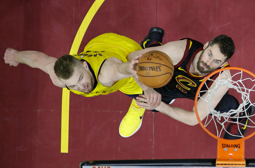 . Indiana Pacers\' Domantas Sabonis, left, from Lithuania, drives to the basket against Cleveland Cavaliers\' Kevin Love in the second half of Game 1 of an NBA basketball first-round playoff series, Sunday, April 15, 2018, in Cleveland. The Pacers won 98-80. (AP Photo/Tony Dejak)
