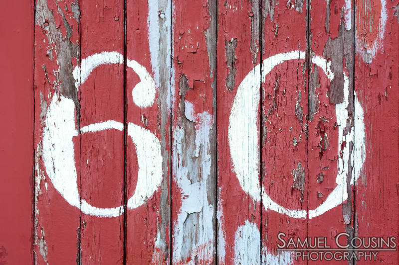 '60' painted on the side of a box car at the Narrow Gauge Railroad on the East End.