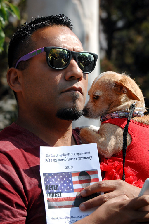 . Anthony Solis holds his dog Khloe at the 9/11 Remembrance Ceremony at the World Trade Center Memorial at LAFD Frank Hotchkin Memorial Training Center, Thursday, September 11, 2013. (Photo by Michael Owen Baker/L.A. Daily News)