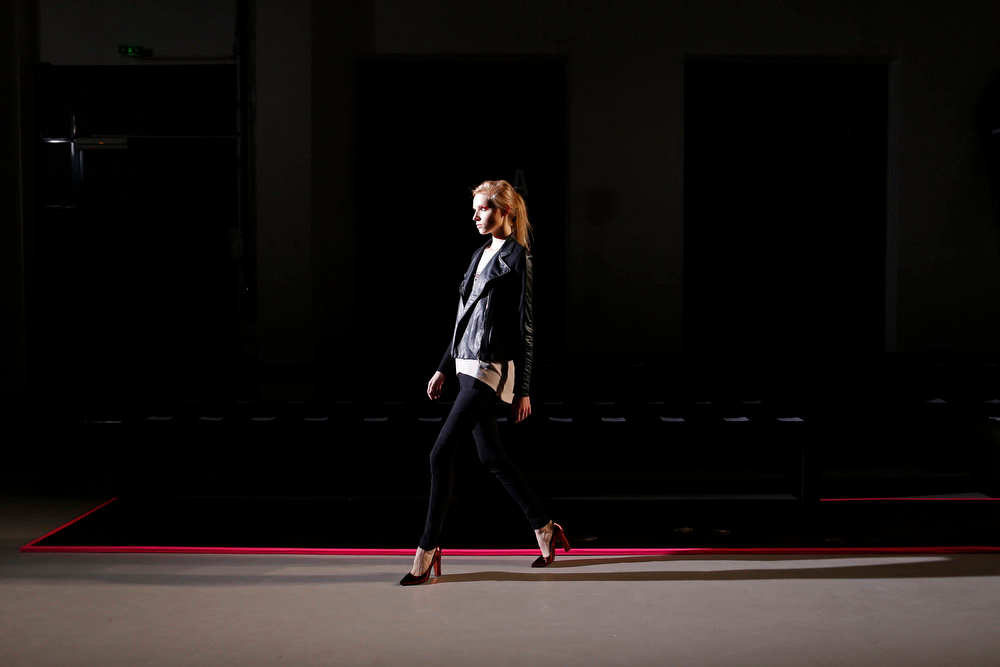 Description of . A model walks during a rehearsal before the presentation of Belgian designer Cedric Charlier Fall-Winter 2013/2014 women\'s ready-to-wear fashion collection during Paris fashion week February 26, 2013. REUTERS/Benoit Tessier