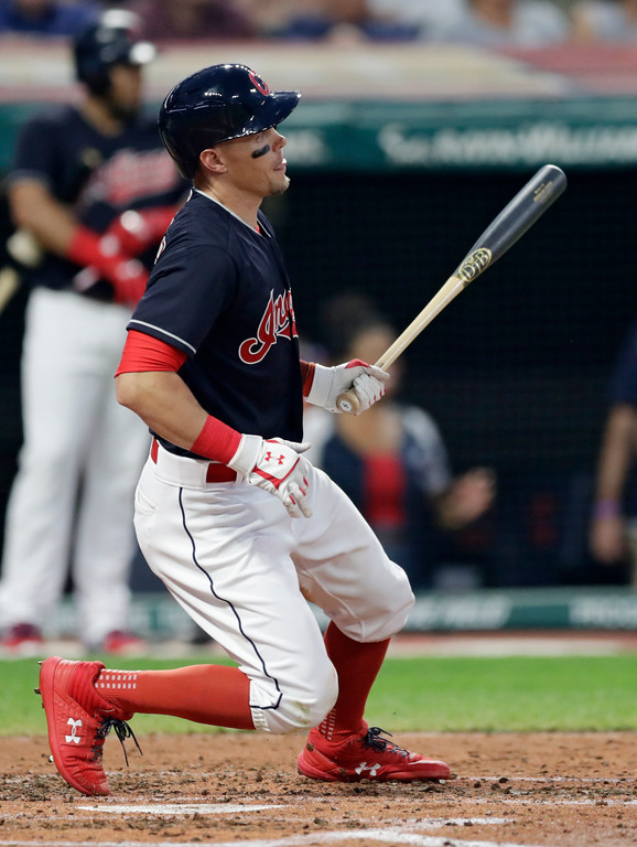 . Cleveland Indians\' Brandon Guyer hits an RBI-single off Kansas City Royals relief pitcher Burch Smith in the second inning of a baseball game, Tuesday, Sept. 4, 2018, in Cleveland. (AP Photo/Tony Dejak)