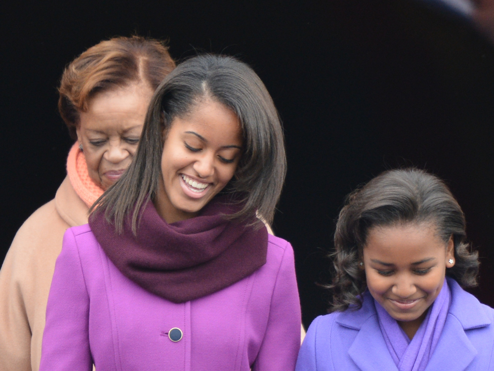 Description of . First daughters Sasha (L) and Malia arrive with their grand-mother, Marian Shields Robinson for the 57th Presidential Inauguration ceremonial swearing-in of President Barack Obama at the US Capitol on January 21, 2013 in Washington, DC. The oath is to be administered by US Supreme Court Chief Justice John Roberts, Jr.    JEWEL SAMAD/AFP/Getty Images