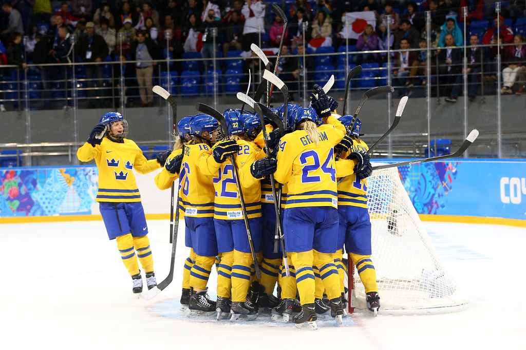 . SOCHI, RUSSIA - FEBRUARY 09:  Members of Sweden ice hockey team celebrate their 1-0 win over Japan during the Women\'s Ice Hockey Preliminary Round Group B Game on day two of the Sochi 2014 Winter Olympics at Shayba Arena on February 9, 2014 in Sochi, Russia.  (Photo by Martin Rose/Getty Images)