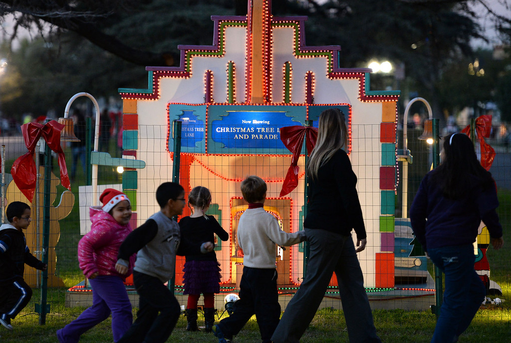 . The 60th annual Daisy Avenue Parade in the Wrigley neighborhood Saturday, December 13, 2013, in Long Beach, CA.    People look at the holiday displays lining Daisy Avenue park before the parade. Photo by Steve McCrank/DailyBreeze