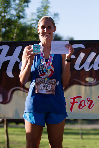The female overall winner of the 2nd Annual Visalia Hot Fudge Sundae Run,  Jennifer Marquez (870) shows off the hardware  from her win, including $50.