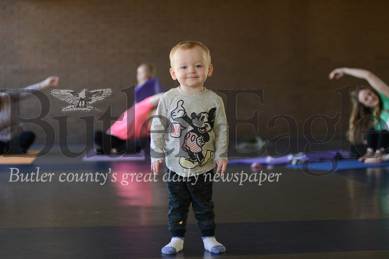 "Cooper Wilson, pictured here at his first yoga class at the Butler YMCA. Sarah Wilson, his mother said they ""really liked"" the class."