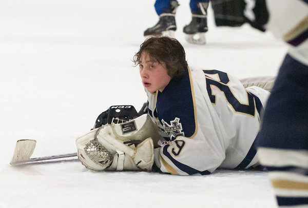 02/26/20 Wesley Bunnell | StaffrrNewington Co-op hockey vs Hall-Southington on Wednesday night at Newington Arena. Newington goalkeeper Andrew Fogarty (29) looks over at teammates after a Hall-Southington goal. Fogarty's helmet fell off as he crashed to the ice during the play.