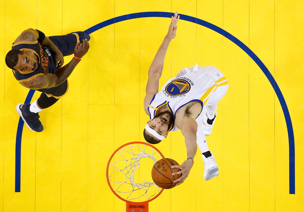 . Golden State Warriors center JaVale McGee (1) dunks against Cleveland Cavaliers guard J.R. Smith during the first half of Game 1 of basketball\'s NBA Finals in Oakland, Calif., Thursday, June 1, 2017. (John G. Mabanglo/Pool Photo via AP)