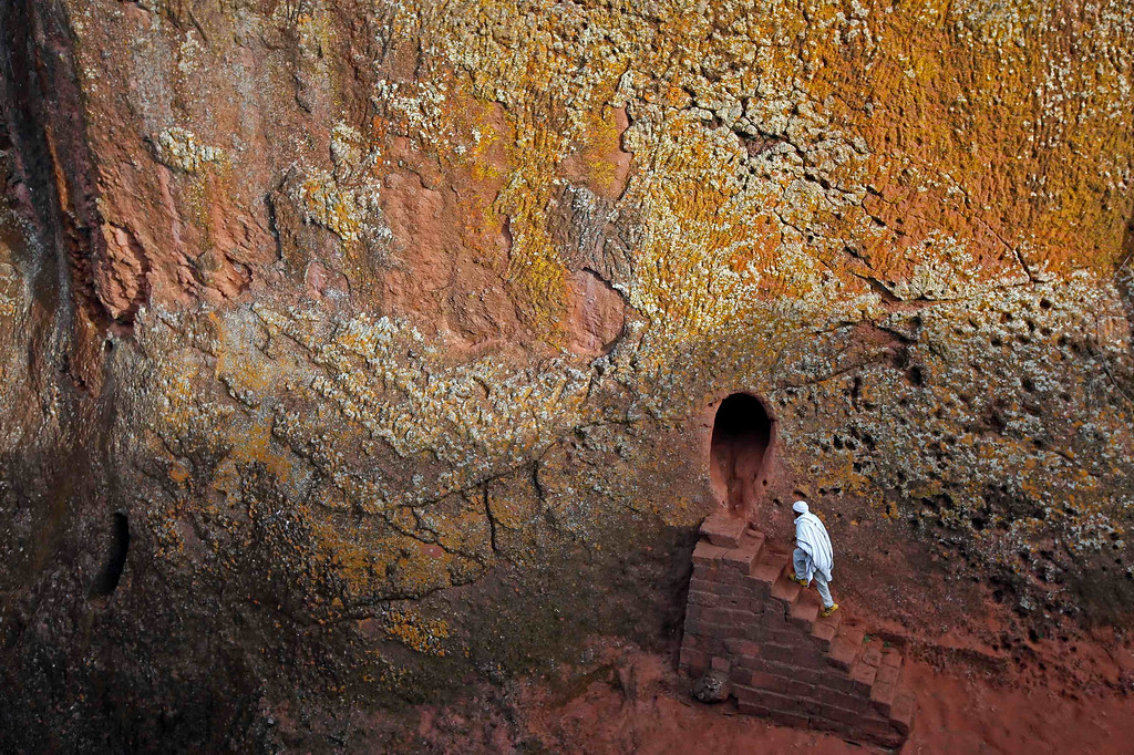 . An Orthodox Christian walks into one of 11 monolithic rock-cut churches, ahead of Orthodox Easter in Lalibela May 4, 2013.  REUTERS/ Goran Tomasevic