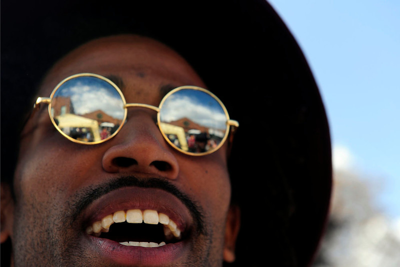 . Beno Ham, 26, of Denver walks through the Five Points Jazz Festival. The festival runs 11am to 8pm on May 18, 2013 and is a free community event highlighting local musicians, art and the historic Denver Five Points neighborhood.  (Photo By Mahala Gaylord/The Denver Post)