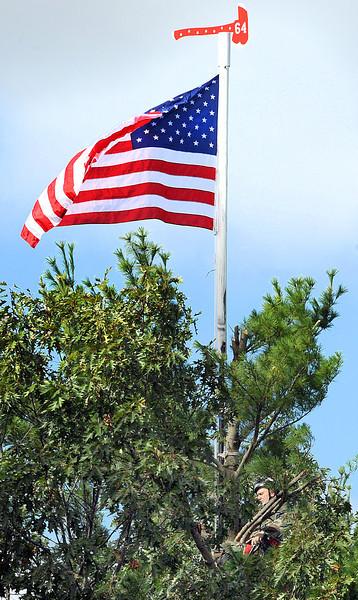 Flag flying again over Veterans Memorial Bridge