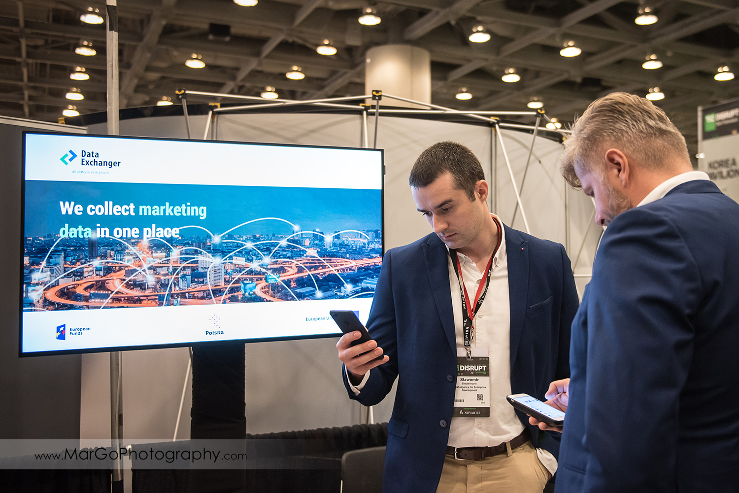 two men in front of Polish ICT promotion stand at Disrupt SF at the Moscone Center West in San Francisco