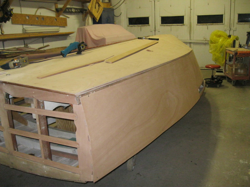 Rear port view of plywood being fit.