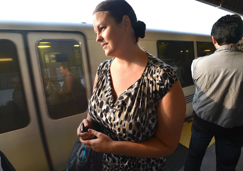 . Lori Myers, of Walnut Creek, stands in line waiting for a BART train  at the Pleasant Hill BART station on her way to her job in San Francisco, where she will get off at the Embarcadero station, in Pleasant Hill, Calif., on Tuesday, July 20, 2013. Myers, a legal secretary by day and dance instructor by night, is one of many Bay Area commuters without the option to telecommute or take advantage of many ride-sharing options if BART goes out on strike. (Dan Rosenstrauch/Bay Area News Group)