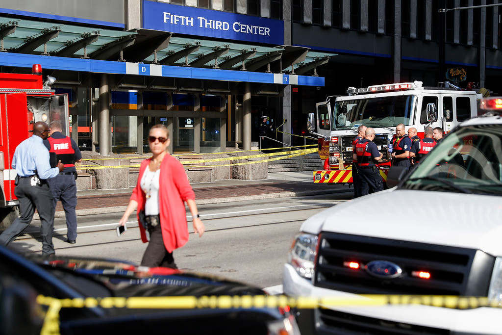 . Emergency personnel and police respond to a reported active shooter situation near Fountain Square, Thursday, Sept. 6, 2018, in Cincinnati. (AP Photo/John Minchillo)