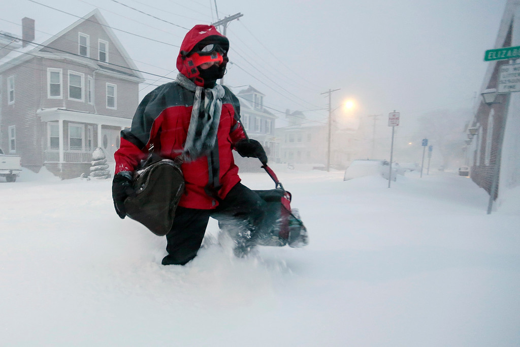. George Mello, a respiratory therapist at St. Lukes Hospital in New Bedford, Mass., is forced to walk to work under blizzard conditions, early Tuesday, Jan. 27, 2015, in New Bedford, Mass. The storm spun up the East Coast early Tuesday, pounding parts of coastal New Jersey northward through Maine with high winds and heavy snow. (AP Photo/Standard Times, Peter Pereira)