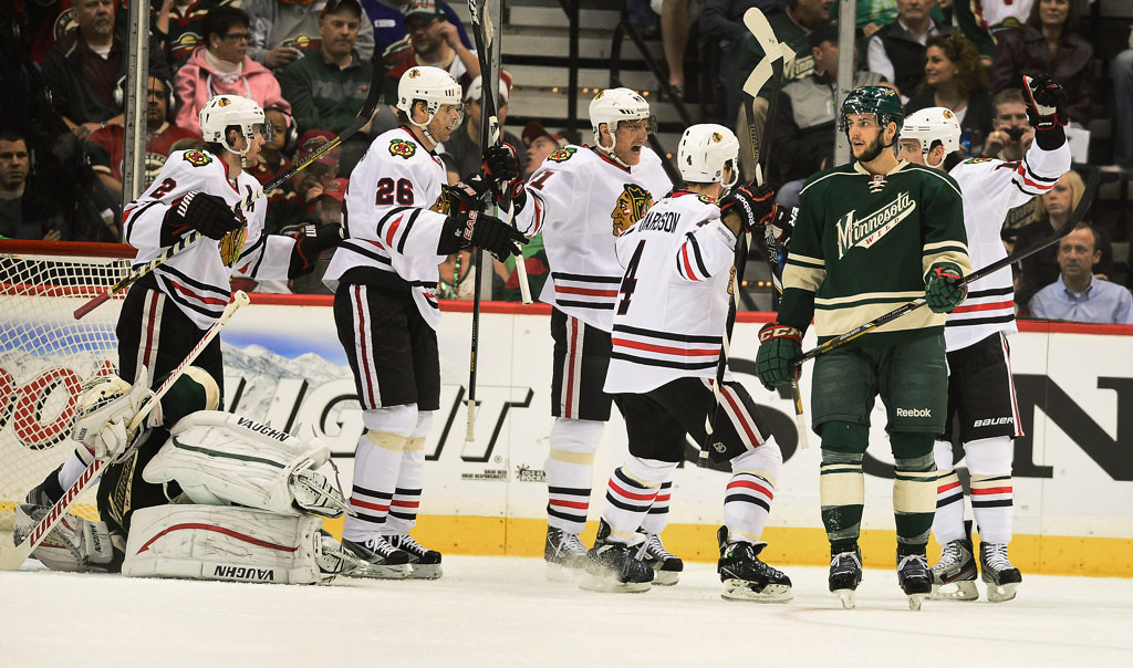 . Chicago players react after teammate Patrick Sharp, far right, scored in the the first period. Minnesota defenseman Marco Scandella is at right. (Pioneer Press: Ben Garvin)