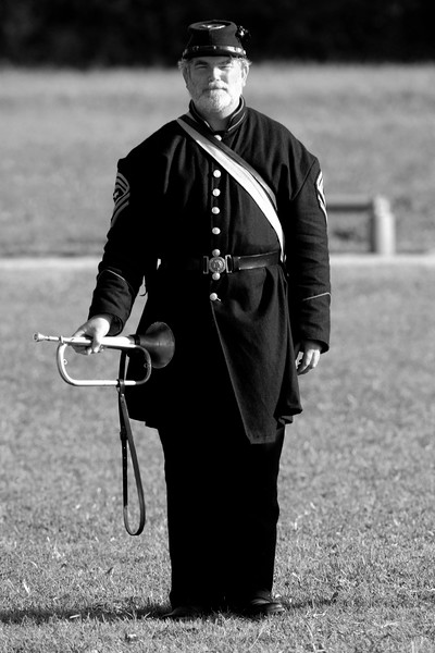 The bugler stands ready for his duty on the field during a parade demonstration at Ft. Moultrie in Sullivan's Island, South Carolina on Monday, April 11, 2011. ..The 150th Anniversary of the Firing on Ft. Sumter was commemorated with lectures, performances, demonstrations, and a living history throughout the area on James Island, Charleston, Mt. Pleasant, and Sullivan's Island during the week from April 8-14, 2011. Photo Copyright 2011 Jason Barnette