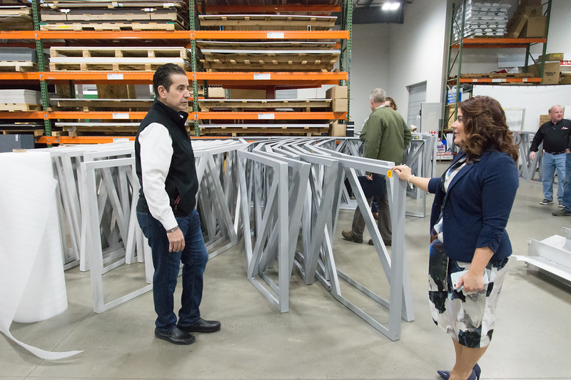 02/15/19  Wesley Bunnell | Staff  Sign Pro President Peter Rappoccio, L, and Mayor Erin Stewart look over decorative trim pieces for the Beehive Bridge that Sign Pro is building at its Southington location. The Mayor, along with other city employees, toured Sign Pro on Friday for progress updates.