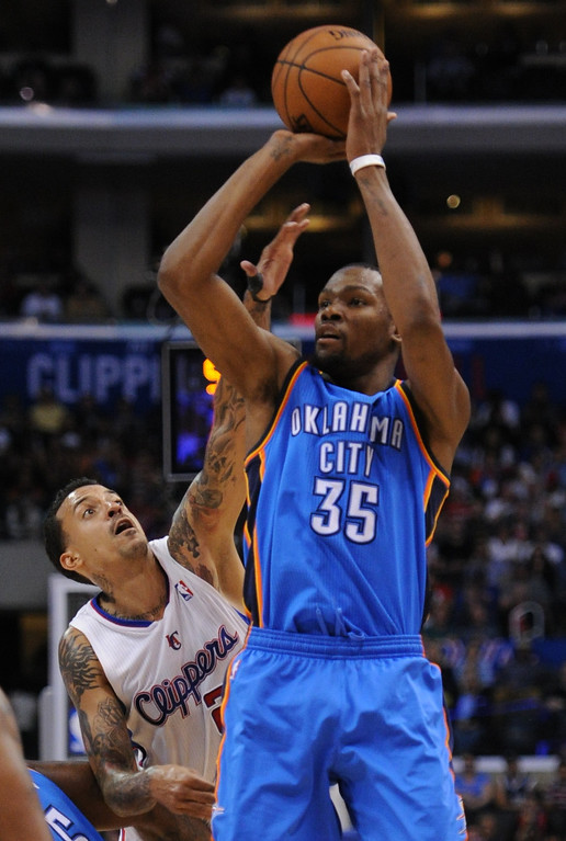 . Thunder#35 Kevin Durant shoots over Clippers#22 Matt Barnes. The Oklahoma City Thunder defeated the Clippers 107-101 in a regular season game at Staples Center in Los Angeles, CA. 4/9/2014(Photo by John McCoy / Los Angeles Daily News)