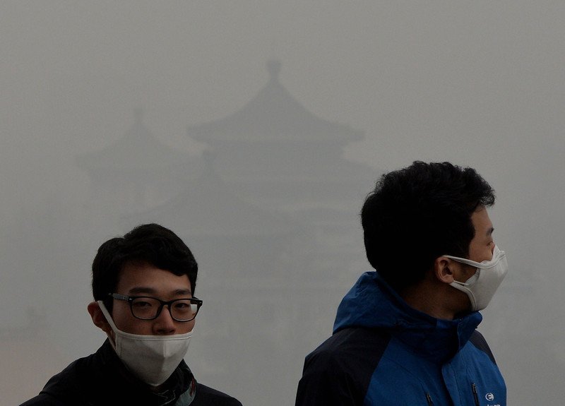 . Tourists wear face masks as they climb Jingshan Hill beside the Forbidden City as heavy air pollution continues to shroud Beijing on February 26, 2014. Beijing\'s official reading for PM 2.5, small airborne particles which easily penetrate the lungs and have been linked to hundreds of thousands of premature deaths, stood at 501 micrograms per cubic metre.  (MARK RALSTON/AFP/Getty Images)
