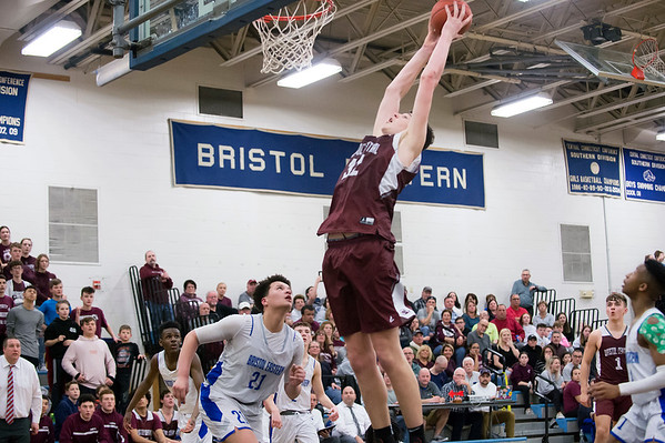 02/24/20 Wesley Bunnell | StaffrrBristol Central's Donovan Clingan (32) stretches for a rebound.