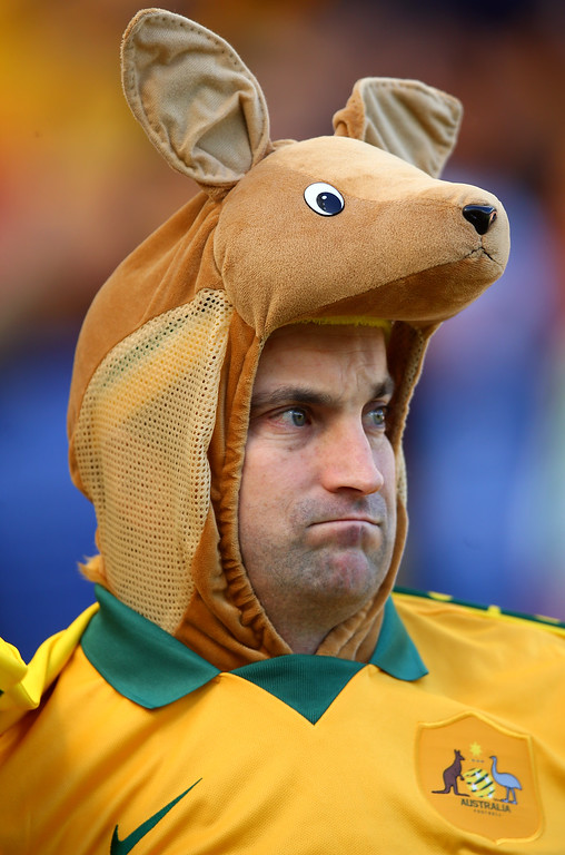 . An Australia fan enjoys the atmosphere prior to the 2014 FIFA World Cup Brazil Group B match between Australia and Netherlands at Estadio Beira-Rio on June 18, 2014 in Porto Alegre, Brazil.  (Photo by Jeff Gross/Getty Images)