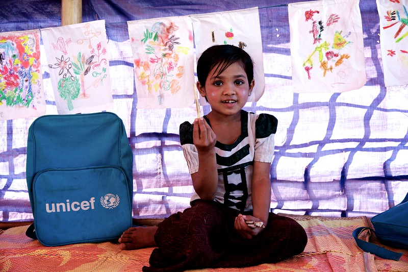 0114-0117Hafsa, an 8-year-old Rohingya child, attends classes at a UNICEF-supported learning centre at the Balukhali makeshift settlement for Rohingya refugees in Ukhia, Cox's Bazar, Bangladesh.     Photo: UNICEF / b.a.sujaN/Map