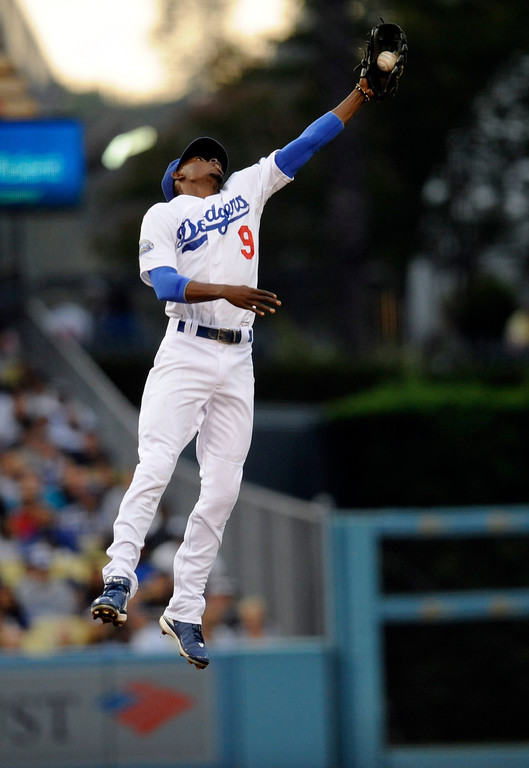 . Dodgers\' Dee Gordon (9) leaps in the air to grab a White Sox\'s Orlando Hudson (5) hit during their game at Dodger Stadium Friday, June 15, 2012. (Hans Gutknecht/Staff Photographer)