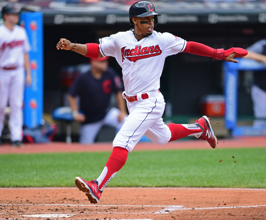 . Cleveland Indians\' Francisco Lindor scores on a one-run double by Edwin Encarnacion in the first inning of a baseball game against the Detroit Tigers, Sunday, June 24, 2018, in Cleveland. (AP Photo/David Dermer)
