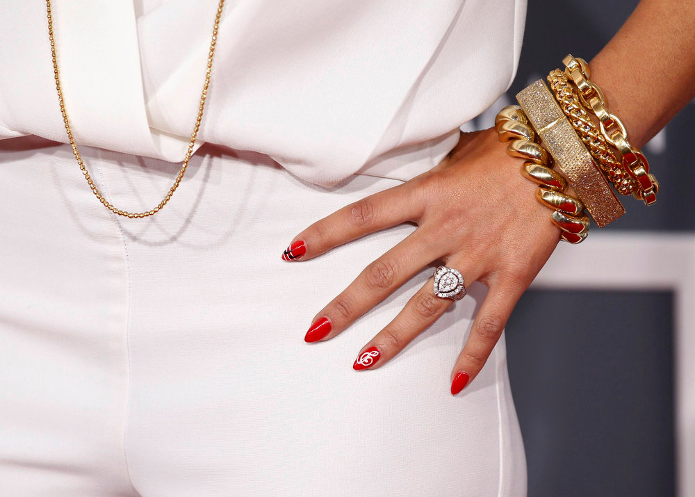 . Television personality Rocsi Diaz wears a Grammy-themed manicure as she arrives at the 55th annual Grammy Awards in Los Angeles, California February 10, 2013.  REUTERS/Mario Anzuoni