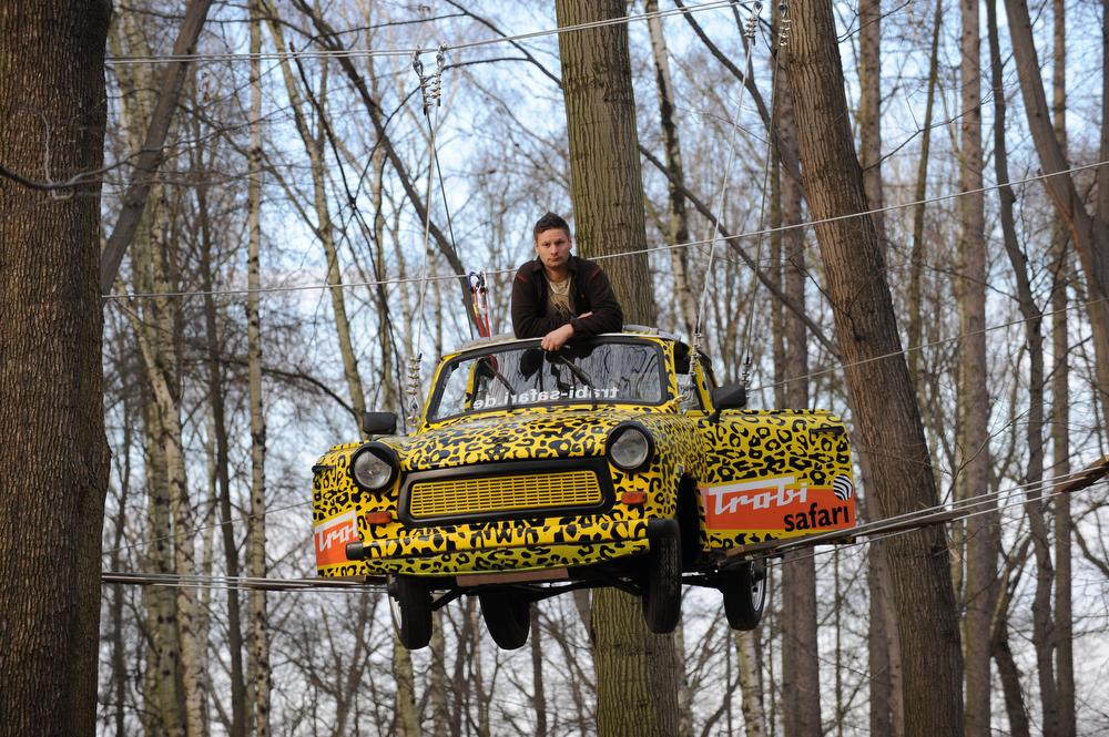 Description of . Maik Dannewitzsch poses in a Trabant car (