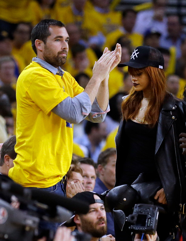 . Musician Rhianna, right, walks to her seat during the second half of Game 1 of basketball\'s NBA Finals between the Golden State Warriors and the Cleveland Cavaliers in Oakland, Calif., Thursday, June 4, 2015. (AP Photo/Ben Margot)