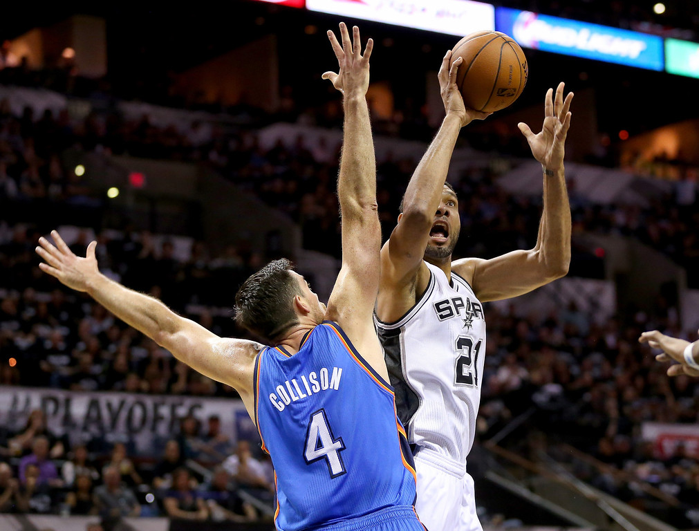 . Tim Duncan #21 of the San Antonio Spurs shoots over Nick Collison #4 of the Oklahoma City Thunder in the first quarter in Game One of the Western Conference Finals during the 2014 NBA Playoffs at AT&T Center on May 19, 2014 in San Antonio, Texas.  (Photo by Ronald Martinez/Getty Images)