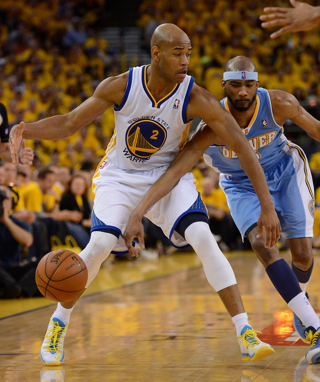 . Corey Brewer (13) of the Denver Nuggets reaches in on Jarrett Jack (2) of the Golden State Warriors during the third quarter in Game 4 of the first round NBA Playoffs April 28, 2013 at Oracle Arena. (Photo By John Leyba/The Denver Post)