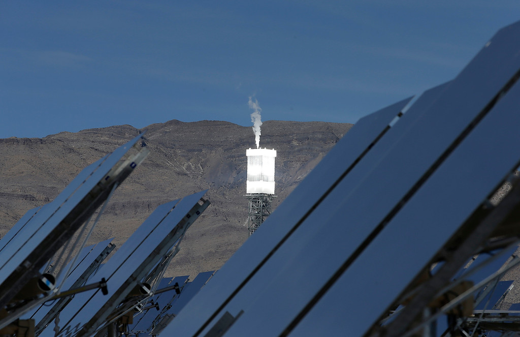 . A boilers sits on 459-foot towers vents steam Tuesday, Feb. 11, 2014 in Primm, Nev. The Ivanpah Solar Electric Generating System, sprawling across roughly 5 square miles of federal land near the California-Nevada border. (AP Photo/Chris Carlson)