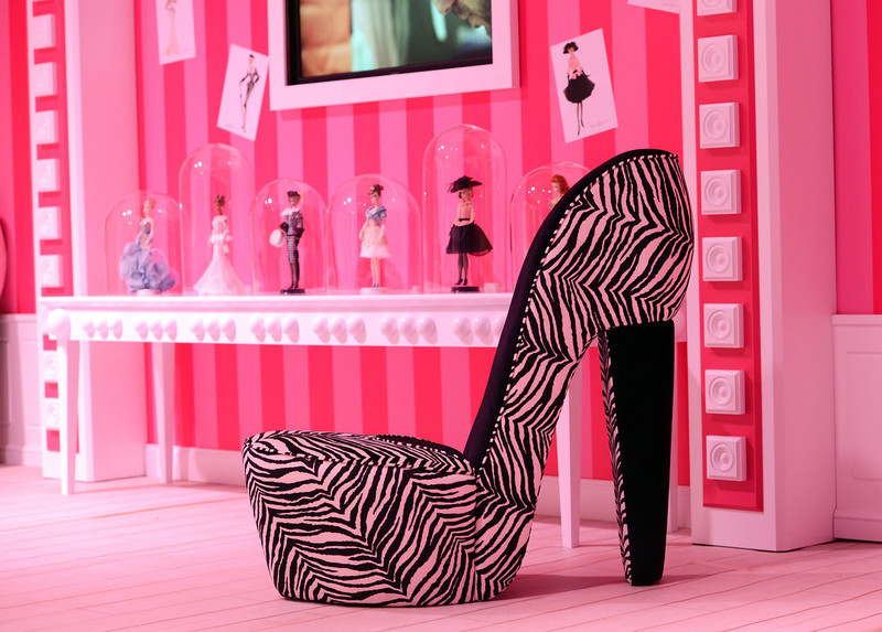 . A chair in the shape of a high-heel is is displayed in the Barbie Dreamhouse Experience near Alexanderplatz square  in Berlin, Germany,Thursday May 16, 2013. The 2,500 square meter Barbie Dreamhouse Experience will be open for three months in Berlin.  (AP Photo/dpa, Jens Kalaene)