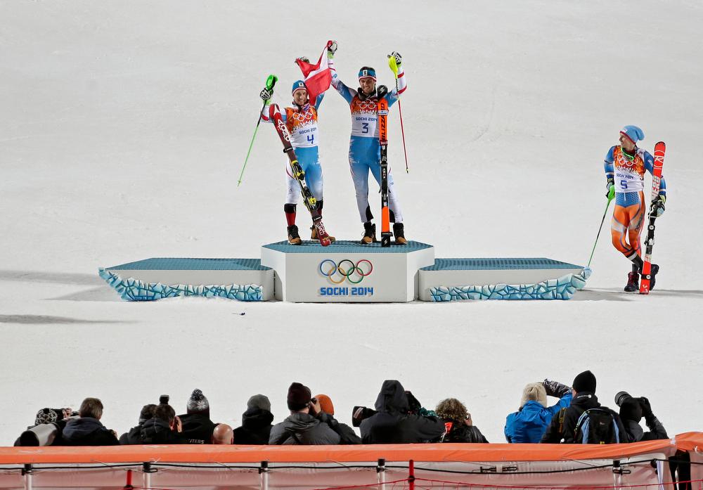 . Men\'s slalom winners Austria\'s Mario Matt (gold), center, and his teammate Austria\'s Marcel Hirscher (silver) celebrate on the podium while bronze medalist, Norway\'s Henrik Kristoffersen, stands at right at the Sochi 2014 Winter Olympics, Saturday, Feb. 22, 2014, in Krasnaya Polyana, Russia. (AP Photo/Charlie Riedel)