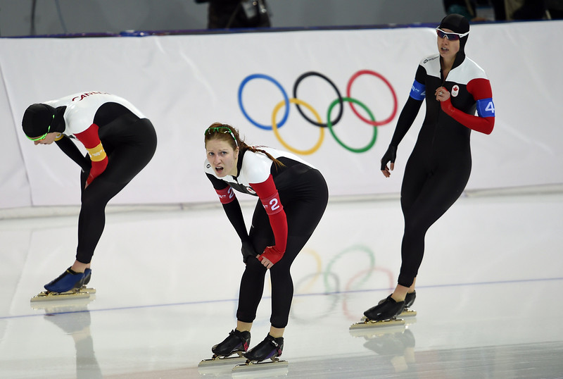 . (From L) Canada\'s Christine Nesbitt, Canada\'s Kali Christ and Canada\'s Brittany Schussler compete in the Women\'s Speed Skating Team Pursuit Quarterfinals at the Adler Arena during the Sochi Winter Olympics on February 21, 2014. (DAMIEN MEYER/AFP/Getty Images)